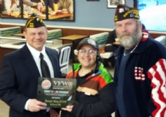 Post Commander Howard Gooldrup presents a plaque to Heather Thibodeau from Burger King with assistance of District 9 Commander Craig DuFour.